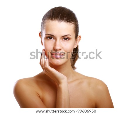 Young woman touching her face , isolated on white background