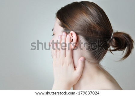 Young woman touching her painful ear - stock photo
