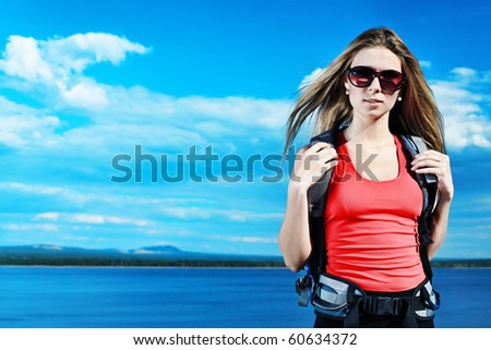 Young woman tourist posing at the mountains. - stock photo