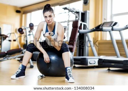 Young woman traiing in the gym - stock photo