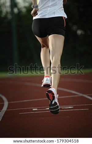 Young woman training and running - stock photo