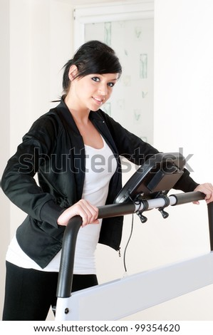 young woman training on ski simulators