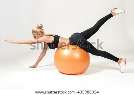 Young woman training with fitball