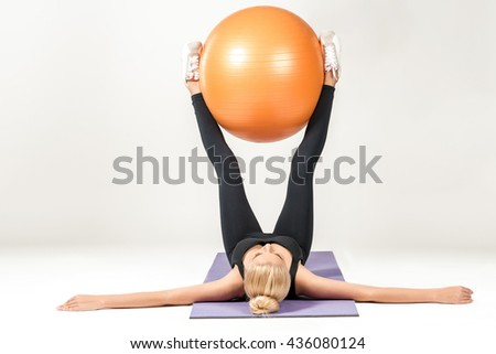 Young woman training with fitball - stock photo