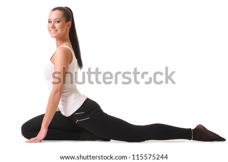 Young woman training yoga - stock photo