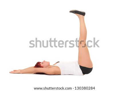 Young woman training yoga.lift the legs up from a supine position - stock photo
