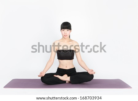 Young woman training yoga on white background - stock photo