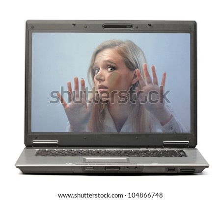 Young woman trapped in a laptop screen - stock photo