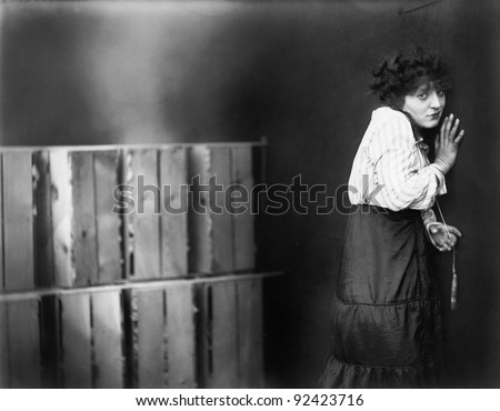 Young woman turning away and looking scared - stock photo