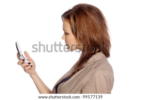 Young woman unhappy at something she sees on her cell phone