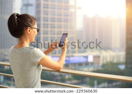 young woman use cellphone in city  - stock photo
