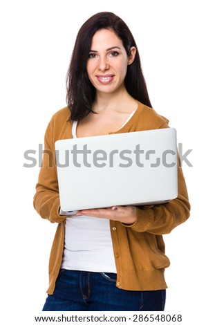 Young woman use of laptop computer - stock photo