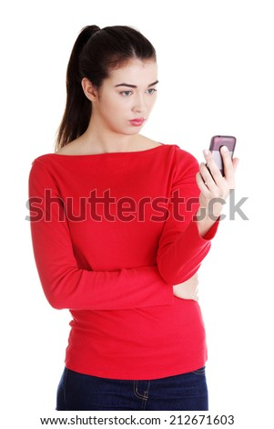 Young woman useing a modern mobile over a white background