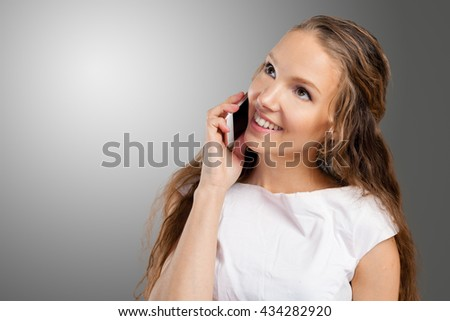 Young Woman Using a Cell Phone - stock photo