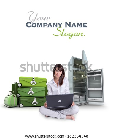 Young woman using a laptop with a pile of suitcases and an empty fridge on the background
