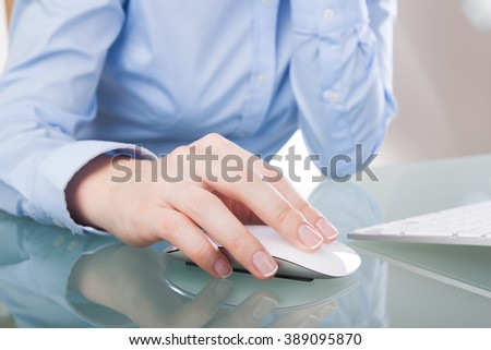 young woman using a mouse at office - stock photo