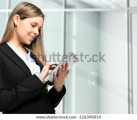 Young woman using a tablet in her office - stock photo
