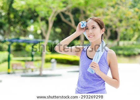 Young woman using blue towel after doing sport exercise - stock photo