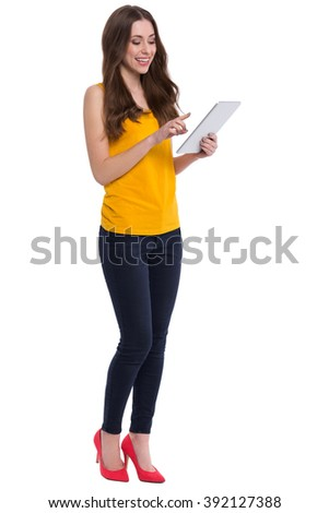 Young woman using digital tablet  - stock photo