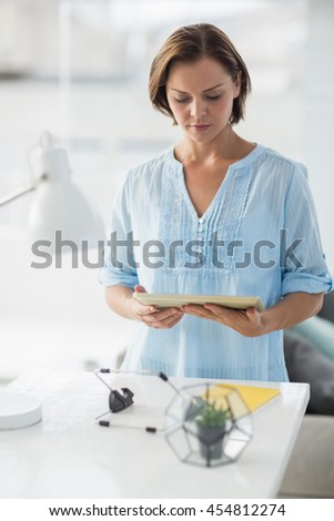 Young woman using digital tablet at home - stock photo