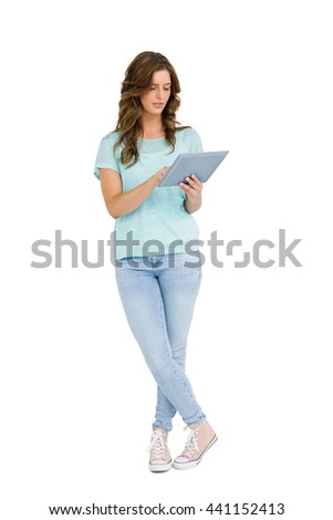 Young woman using digital tablet on white background