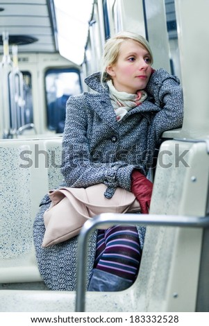 Young Woman Using Environmental Public Transportation to go Back Home After Work - stock photo