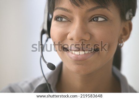 Young woman using headset - stock photo