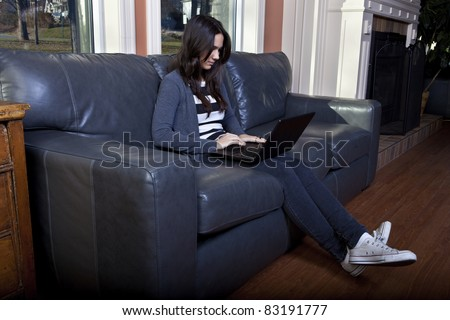 Young woman using laptop - stock photo
