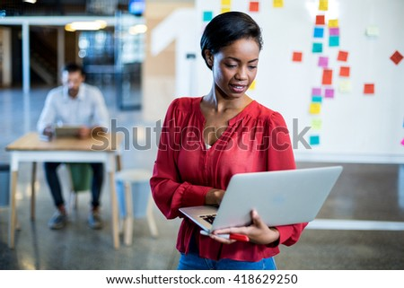 Young woman using laptop in the office