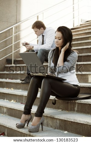 Young woman using laptop on the steps