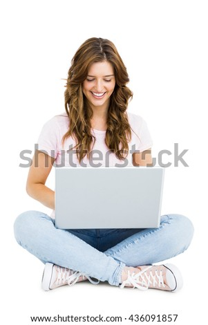 Young woman using laptop on white background