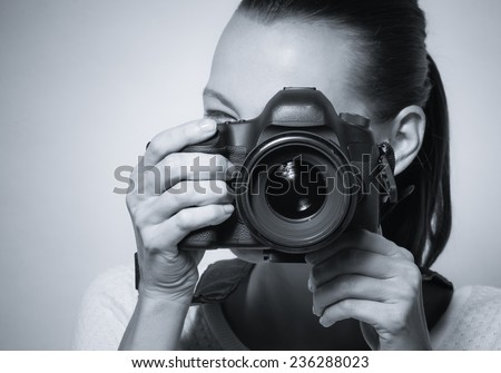 Young woman using professional camera