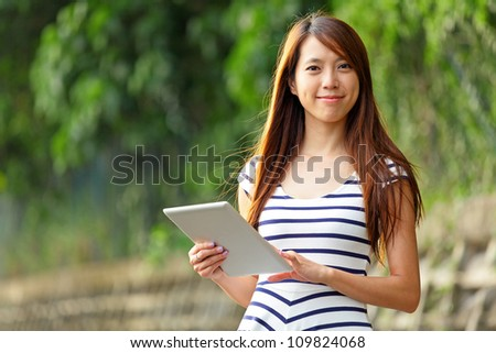 young woman using tablet touch computer - stock photo
