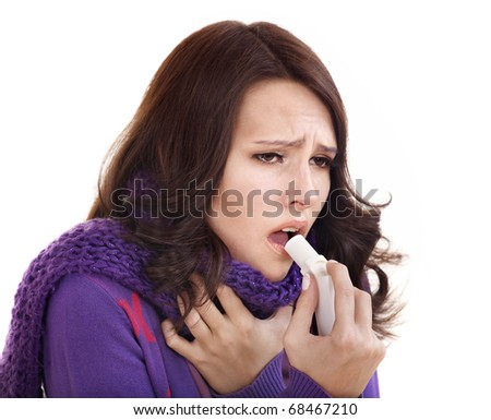 Young woman using throat spray. - stock photo