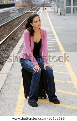 young woman waiting for the train - stock photo