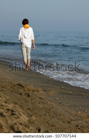 young woman walked on the beach, summer