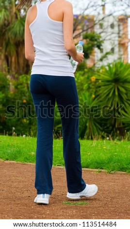 Young woman walking at the park to burn some calories and stay slim