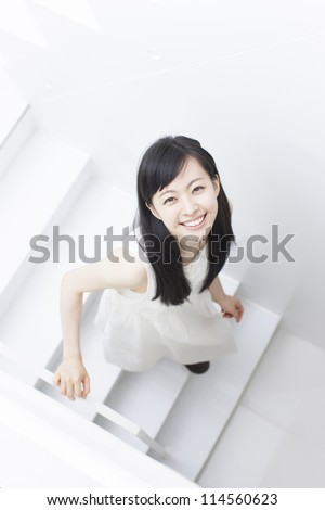 young woman walking down stairs