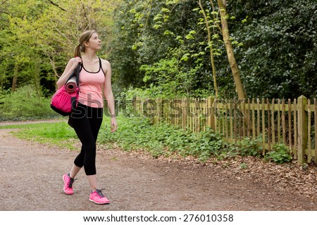 young woman walking home from the gym