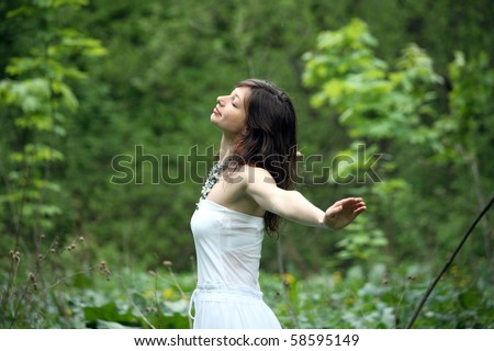 Young woman walking in a forest, freedom - stock photo