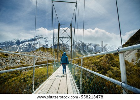 Young woman walking in hooker valley track, New Zealand