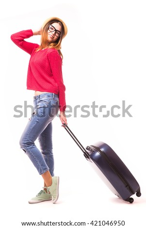 Young woman walking with travel bag.
