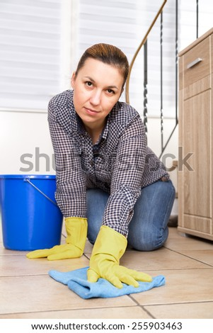Young woman washing furniture at home.