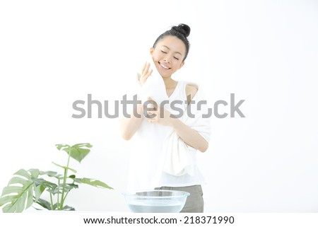 young woman washing her face - stock photo