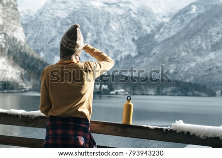 Young woman watching scenery. Balcony view. Lakeside view. Lifestyle concept.