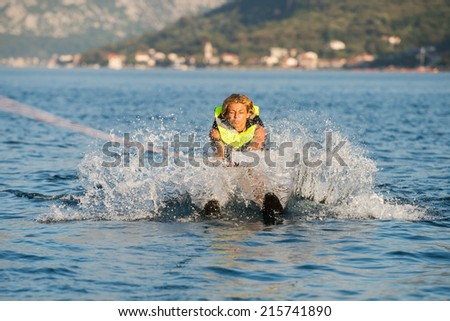 young woman water skiing on a sea - stock photo
