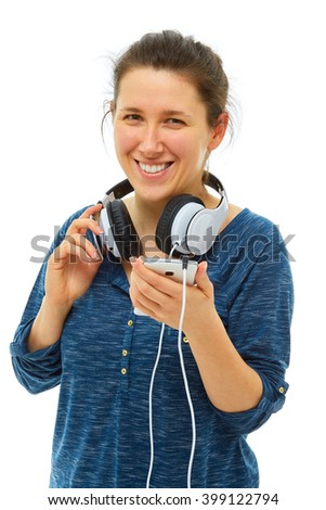 Young woman wear white big headphones, isolated over white background - stock photo