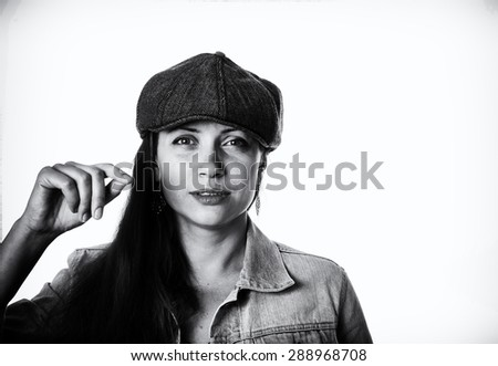 Young woman wearing a cap. Black and white portrait - stock photo