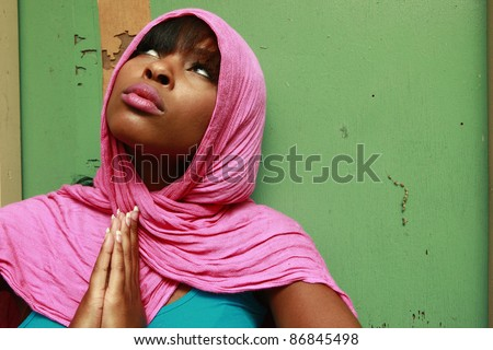 Young woman wearing a scarf - stock photo