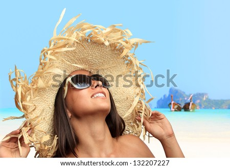 Young woman wearing a straw hat at Koh Phi Phi island at day time, Thailand